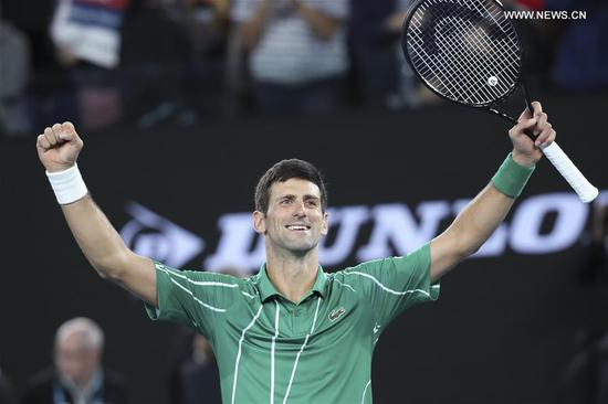 Novak Djokovic of Serbia celebrates after the men's singles final against Dominic Thiem of Austria at 2020 Australian Open in Melbourne, Australia on Feb. 2, 2020. (Xinhua/Bai Xuefei)
