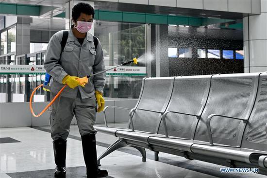 A staff member disinfects the waiting room of Fuzhou Railway Station in Fuzhou, southeast China's Fujian Province, Feb. 2, 2020. Various measures have been taken for epidemic prevention efforts across China. (Xinhua/Jiang Kehong)