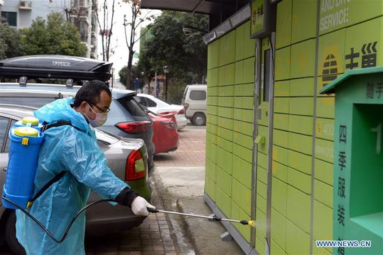 A staff member disinfects in a community in Hefei, east China Anhui Province, Feb. 2, 2020. Various measures have been taken for epidemic prevention efforts across China. (Xinhua/Huang Bohan)