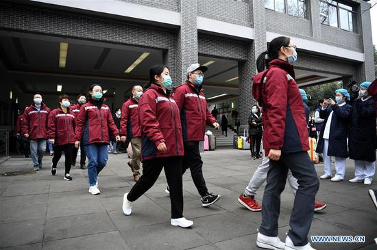 Medical team members head to the airport before leaving for Hubei Province at West China Hospital of Sichuan University in Chengdu, capital of southwest China's Sichuan Province, Feb. 7, 2020. A medical team comprised of 131 members left Chengdu for Wuhan on Friday to aid the novel coronavirus control efforts there. (Xinhua/Wang Xi)