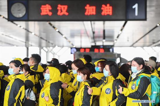 Medical team members of the Third Xiangya Hospital of Central South University gather at Changsha South Railway Station in Changsha, central China's Hunan Province, Feb. 8, 2020. Medical workers of the third batch from the Second Xiangya Hospital of Central South University and the first batch from the Third Xiangya Hospital of Central South University set off for Wuhan on Saturday, the Chinese Lantern Festival, to aid the novel coronavirus control efforts there. (Xinhua/Chen Zeguo)