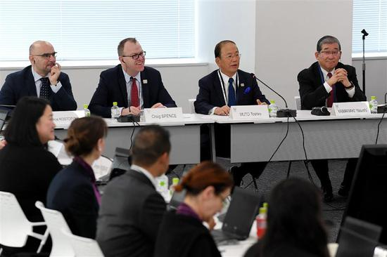 Chief Executive Officer of the Tokyo Olympics Toshiro Muto (second right) and Craig Spence (second left), head of communications of the International Paralympic Committee, attend the IPC project review meeting for the Tokyo 2020 Paralympic Games in Tokyo on February 5, 2020.