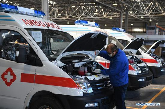 A staff member works in a factory of negative pressure ambulance of SAIC Motor Co., Ltd. in Wuxi, east China's Jiangsu Province, Feb. 16, 2020. The company rushes to make negative pressure ambulances to meet the needs of hospitals in the prevention and control of the novel coronavirus pneumonia epidemic. (Xinhua/Ji Chunpeng)