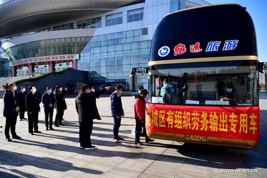 A batch of workers bound for east China's Fujian Province take the special bus to leave at Nanyang sports center in Nanyang, central China's Henan Province, Feb. 16, 2020. Nanyang has taken a lot of measures recently to help local workers back to work and promote the export of labor services, diminishing the impact of the novel coronavirus epidemic on the economy. (Xinhua/Feng Dapeng)