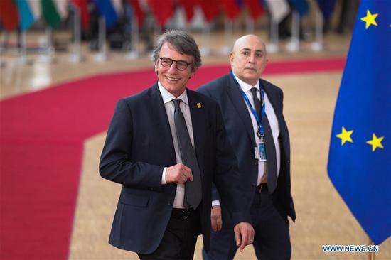 """File photo shows President of the European Parliament David Sassoli (L) arriving for a special meeting of the European Council at the EU headquarters in Brussels, Belgium, Feb. 20, 2020. Sassoli said on Tuesday that he will work from home in Brussels, after spending a weekend in Italy. """"I have decided after having been in Italy over the last weekend, as a precaution, to follow the indicated measures and to exercise my function as president from my home in Brussels in compliance with the 14 days indicated by the health protocol,"""" Sassoli said in a statement posted by the EP. (Xinhua/Zheng Huansong)"""