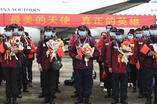 Medics supporting virus-hit Hubei Province arrive at Nanning Wuxu International Airport in Nanning, south China's Guangxi Zhuang Autonomous Region, March 20, 2020. The second batch of the medical assistance team from Guangxi, which consist of 136 members, had left Hubei Province, as the epidemic outbreak in the hard-hit province has been subdued. (Xinhua/Cao Yiming)