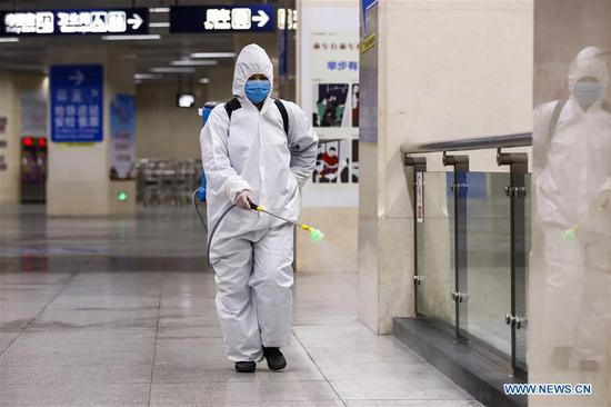 A staff conducts disinfection at the subway station of Hankou Railway Station in Wuhan, central China's Hubei Province, March 23, 2020. Wuhan is making preparations for restoring the operation of public transportation. The public need to go through real-name registration for taking public transportation or taxis in Wuhan, capital of central China's Hubei Province, authorities said Sunday. (Xinhua/Shen Bohan)