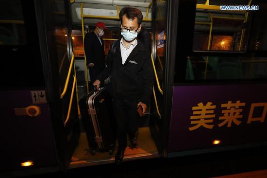 A passenger gets off a bus in Wuhan, central China's Hubei Province, March 25, 2020. Wuhan, the once hardest-hit city in central China's Hubei Province during the COVID-19 outbreak, resumed a total of 117 bus routes starting Wednesday, around 30 percent of the city's total bus transport capacity, the municipal transport bureau said. According to a spokesperson of the bureau, passengers must wear masks, register with their names and scan a QR code, and take a temperature check before taking buses and subways. (Xinhua/Shen Bohan)