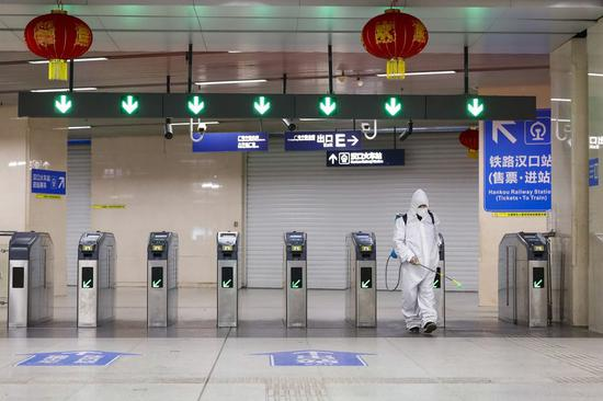 A staff member conducts disinfection at a subway station in Wuhan, central China's Hubei Province, March 23, 2020. (Xinhua/Shen Bohan)