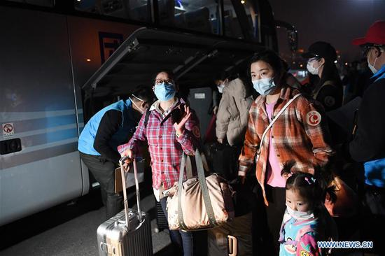 People returning from Hubei arrive at a gathering point in Chaoyang District in Beijing, capital of China, March 25, 2020. The first batch of over 800 people stranded in virus-hit Hubei Province has arrived in Beijing Wednesday afternoon after Hubei lifted outbound travel restrictions in all areas except the capital city Wuhan starting from Wednesday. (Xinhua/Ju Huanzong)