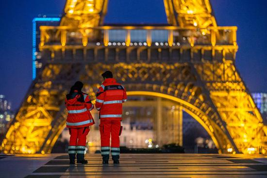 The Eiffel Tower glitters twice as long as usual to thank and support hospital staff during the outbreak of the coronavirus pandemic in Paris, France, March 23, 2020.(Photo by Aurelien Morissard/Xinhua)