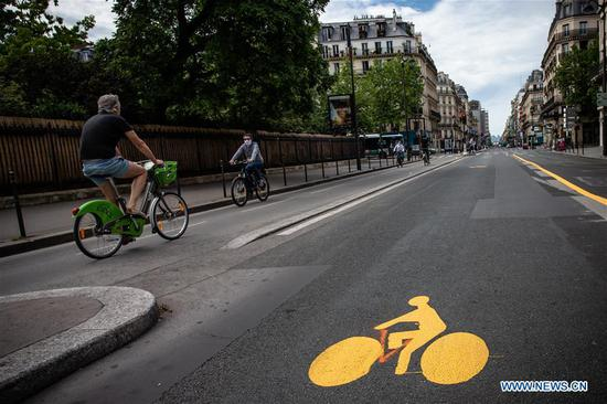 Temporary bike paths are being set up in Paris, France, on May 8, 2020, France would start to ease restrictions on movement from next Monday through