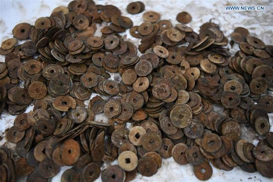 Photo taken on May 12, 2020 shows ancient coins found on the shipwreck of Nanhai No. 1 in Yangjiang, south China's Guangdong Province. The excavation of the Nanhai No. 1, a shipwreck dating back to the Song Dynasty (960 A.D.-1279 A.D.), has entered the final stage and is expected to conclude in 2021, according to the excavation team. The excavation the ancient shipwreck was listed by China in its top 10 archaeological discoveries for 2019. (Xinhua/Deng Hua)