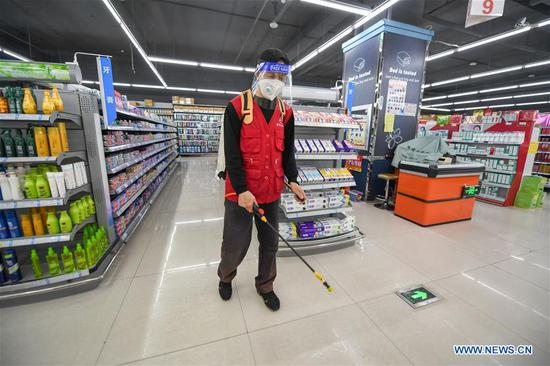 A staff member conducts disinfection at a supermarket in Shulan, northeast China's Jilin Province, May 20, 2020. Shulan, a county-level city in northeast China's Jilin Province, on Monday imposed complete closed-off management for local residential communities with confirmed or suspected COVID-19 cases. Local residential communities with confirmed or suspected cases are under complete close-off management, basically allowing no people to come in and go out without authorization. The stores and supermarkets are responsible for delivering daily necessities. (Xinhua/Zhang Nan)