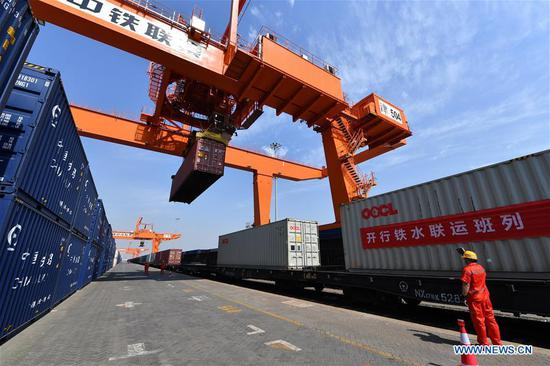 A staff member works for the departure of China-Europe freight train X9202 at the Tianjin Pilot Free Trade Zone (FTZ) in north China's Tianjin Municipality, May 20, 2020. The freight train loaded with cars, accessories, food and clothing set off Wednesday from Tianjin to Ulan Bator of Mongolia. This was the first train on the China-Europe freight route that departed from the Tianjin Pilot Free Trade Zone since it was established in 2015. (Xinhua/Li Ran)