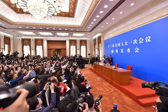 Zhang Yesui, spokesperson for the first session of the 13th National People's Congress (NPC), attends a press conference on the NPC session at the Great Hall of the People in Beijing, capital of China, March 4, 2018. (Xinhua/Li Xin)