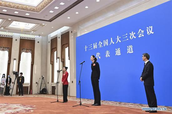 Deputies to the 13th National People's Congress (NPC) are interviewed via video link before the opening meeting of the third session of the 13th NPC in Beijing, capital of China, May 22, 2020. (Xinhua/Liu Jinhai)
