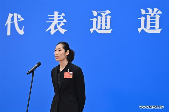 Zhu Ting, a deputy to the 13th National People's Congress (NPC), is interviewed via video link before the opening meeting of the third session of the 13th NPC in Beijing, capital of China, May 22, 2020. (Xinhua/Liu Jinhai)