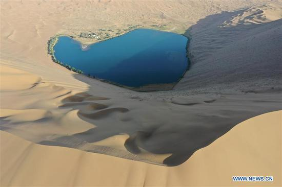 Aerial photo taken on May 29, 2020 shows a lake in Badain Jaran Desert, north China's Inner Mongolia Autonomous Region. There are many lakes in the Badain Jaran Desert, which constitute a beautiful picture with deserts and plants. (Xinhua/Xu Qin)