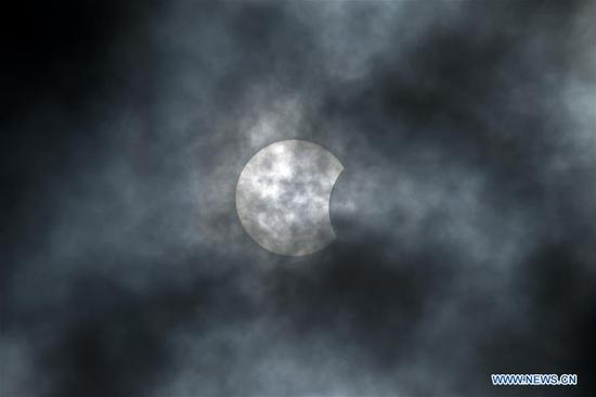 A partial solar eclipse is seen in Kuala Lumpur, Malaysia, on June 21, 2020. (Photo by Chong Voon Chung/Xinhua)