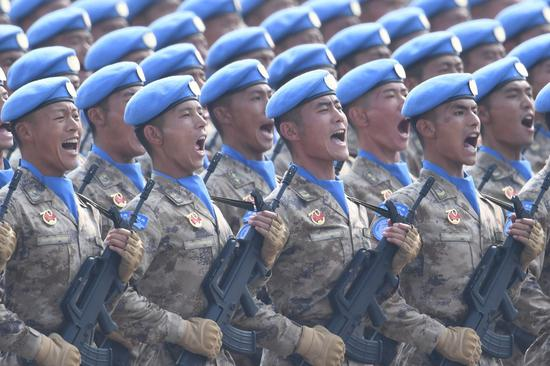 A formation of Chinese peacekeepers take part in a grand military parade celebrating the 70th founding anniversary of the People's Republic of China in Beijing, capital of China, Oct. 1, 2019. (Xinhua/Liu Dawei)