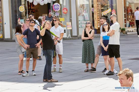 Tourists visit the inner city of Vienna, Austria, on June 27, 2020. A number of European countries recently started exiting border controls cautiously at different paces while striving to reduce tourism fallout. (Photo by Georges Schneider/Xinhua)