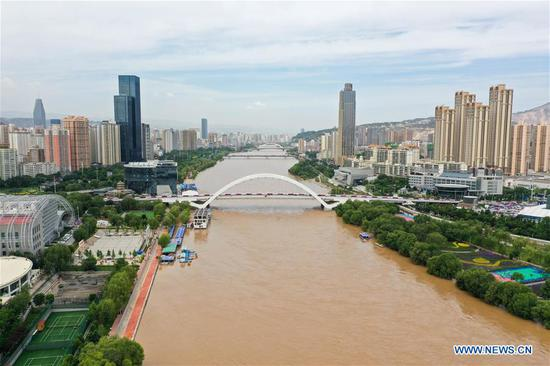 Aerial photo taken on June 27, 2020 shows the Yellow River in Lanzhou, northwest China's Gansu Province. Water level of the Lanzhou section of the Yellow River has risen due to continous rainfall and operations of reservoirs in the upper reaches. Some tourist attractions and facilities along the river have been temporarily closed. (Photo by Lang Bingbing/Xinhua)