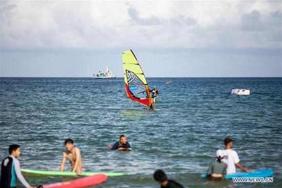 Photo taken on June 27, 2020 shows people relaxing in the sea in Sanya, south China's Hainan Province. (Xinhua/Zhang Liyun)