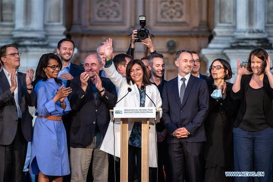 The incumbent mayor of Paris, Anne Hidalgo (C) celebrates after winning the second round of the French Municipal elections in Paris, France, June 28, 2020. Previously scheduled for March 22, the voting took place after the government started a gradual exit in mid-May from months-long restrictions in response to the spread of COVID-19. (Photo by Aurelien Morissard/Xinhua)
