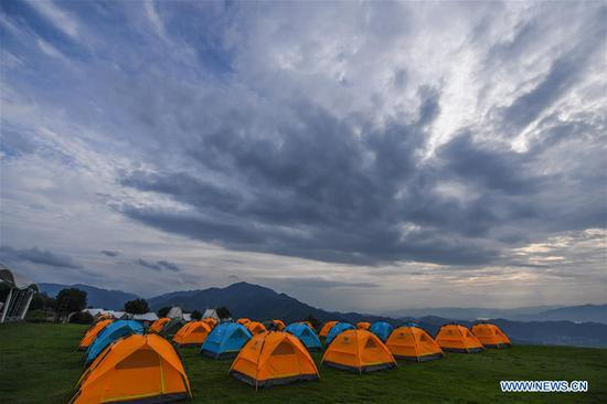 Photo taken on June 27, 2020 shows a glamping resort on top of Yongan Mountain in Chang'an Township of Fuyang District, Hangzhou, east China's Zhejiang Province. Township-level governments in Fuyang District have worked in collaboration to maximize the Huyuan River's ecological resources and promote local ecotourism. (Xinhua/Xu Yu)