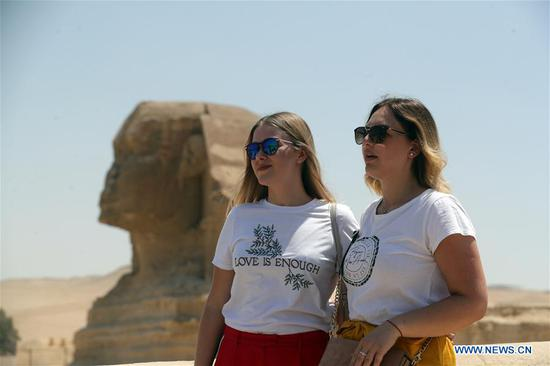 Tourists pose for photos near the Sphinx in Giza, Egypt, on July 1, 2020. Egypt reopened on Wednesday the Egyptian Museum, the Giza Pyramids, and Temple of Luxor for the first time since the COVID-19 closure in March. (Xinhua/Ahmed Gomaa)