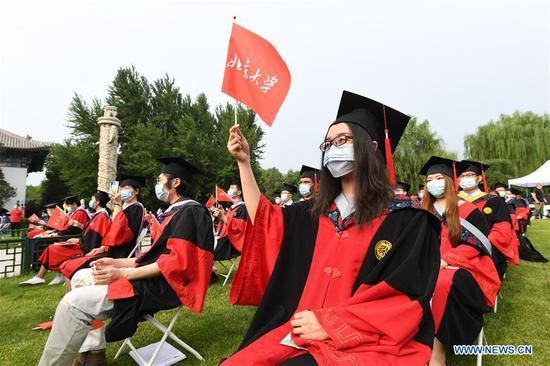 Graduates attend the commencement ceremony of Peking University in Beijing, capital of China, July 2, 2020. Peking University held its commencement ceremony in Beijing on Thursday. Due to COVID-19 prevention and control measures, a limited number of graduates attended the ceremony at nine venues on site while others participated online. (Xinhua/Ren Chao)