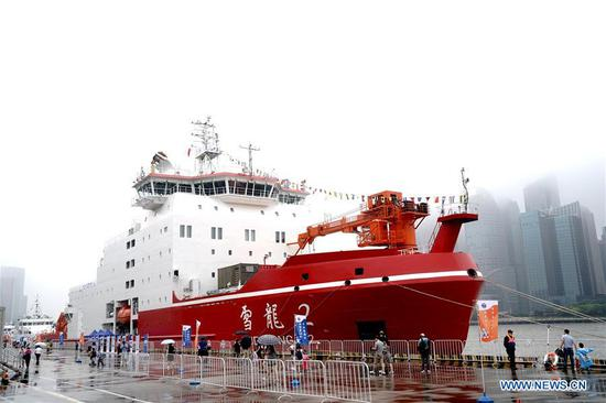Xuelong 2, or Snow Dragon 2, China's first domestically built polar icebreaker, moors at a port in Shanghai for a Maritime Day theme activity on July 11, 2020. July 11 marks the Maritime Day of China. (Xinhua/Zhang Jiansong)