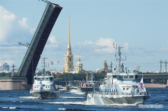 Russian navy ships sail during a military parade to celebrate Russian Navy Day in St. Petersburg, Russia, July 26, 2020. The naval parade in St. Petersburg involved 46 ships and submarines, more than 40 planes and helicopters, and over 4,000 servicemen. Smaller celebrations were held in the country's other fleet bases. Russia marks its Navy Day annually on the last Sunday of July. (Photo by Irina Motina/Xinhua)