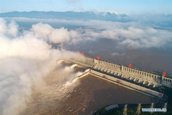 Aerial photo taken on July 27, 2020 shows floodwater being discharged from the Three Gorges Dam in central China's Hubei Province. The third flood of the year in the Yangtze River occurred in its upper reaches as the Three Gorges reservoir saw an inflow of 50,000 cubic meters per second at 2 p.m. Sunday. (Photo by Wang Gang/Xinhua)