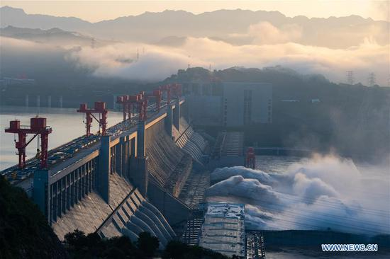 Photo taken on July 27, 2020 shows floodwater being discharged from the Three Gorges Dam in central China's Hubei Province. The third flood of the year in the Yangtze River occurred in its upper reaches as the Three Gorges reservoir saw an inflow of 50,000 cubic meters per second at 2 p.m. Sunday. (Photo by Zheng Jiayu/Xinhua)