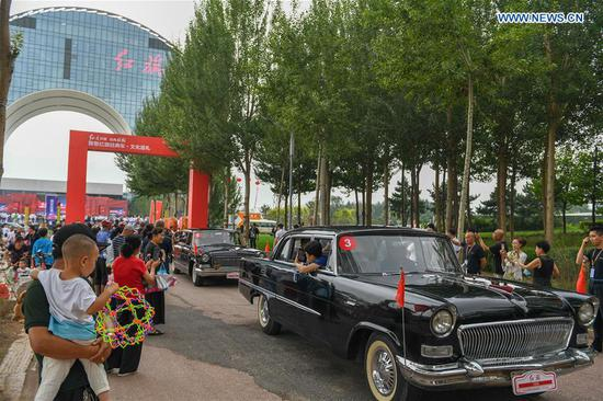 A fleet of vehicles start an urban tour during an event showcasing the products and culture of China's iconic auto brand Hongqi in Changchun, northeast China's Jilin Province, July 28, 2020. (Xinhua/Zhang Nan)