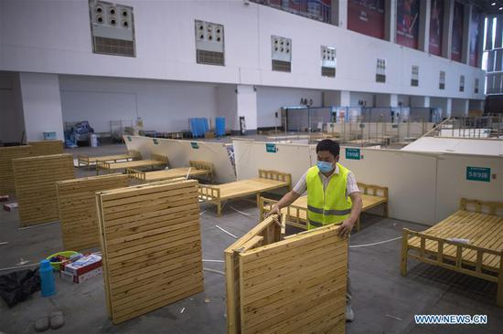 A worker removes hospital facilities at the