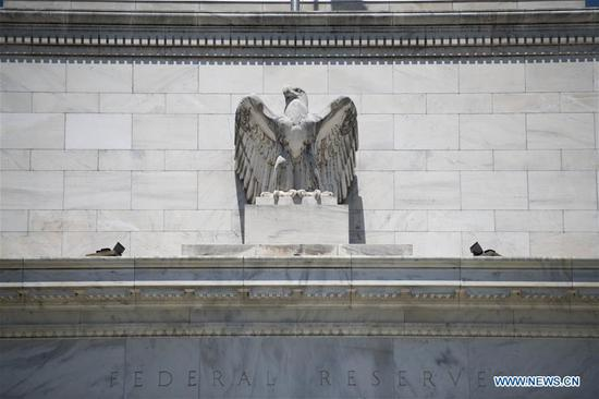 Photo taken on July 29, 2020 shows the U.S. Federal Reserve building in Washington, D.C., the United States. The U.S. Federal Reserve on Wednesday kept its benchmark interest rate unchanged at the record-low level of near zero amid a recent resurgence in COVID-19 cases nationwide. (Xinhua/Liu Jie)
