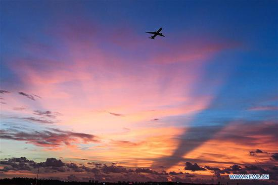 An aircraft conducts a test flight for the second phase of the expansion project of the Haikou Meilan International Airport in Haikou, south China's Hainan Province, July 30, 2020. The second phase of the airport expansion project started test flight on Thursday. (Xinhua/Pu Xiaoxu)