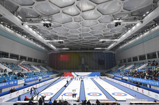 Photo taken on Dec. 8, 2019 shows an audience watching the 2019 China Junior Curling Open girls' final match at the National Aquatics Center (the Water Cube) in Beijing. (Xinhua/Ju Huanzong)
