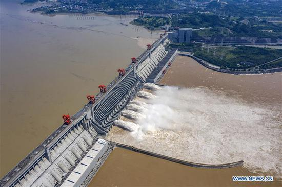 Aerial photo taken on July 31, 2020 shows floodwater being discharged from the Three Gorges Dam in central China's Hubei Province. The third flood of China's Yangtze River this year has smoothly passed the Three Gorges Dam on Wednesday as the water-inflow rate into the reservoir has decreased to 34,000 cubic meters per second. (Xinhua/Du Huaju)