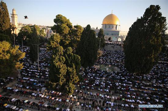 Muslim worshippers pray as they mark Eid al-Adha on the compound known to Muslims as Noble Sanctuary and to Jews as Temple Mount in Jerusalem's Old City, on July 31, 2020. (Photo by Muammar Awad/Xinhua)