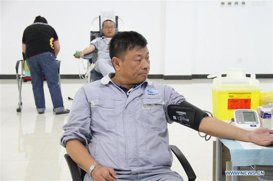 A staff member of Hengyi Industries Sdn Bhd has physical examination before participating in a blood donation in Bandar Seri Begawan, capital of Brunei, Aug. 13, 2020. Hengyi Industries Sdn Bhd, a China-Brunei petrochemical joint venture, held a blood donation drive on Wednesday and Thursday in collaboration with Brunei's Jerudong Park Medical Center, with the participation of over 60 Hengyi staff and management. (Xinhua)