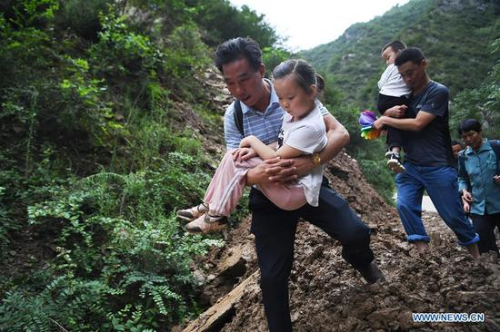 NW China's city takes measures to ensure students safety on way to school after landslide  - China News - SINA English