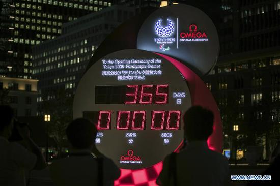 Photo taken on Aug. 24, 2020 shows a countdown clock displaying 365 days to go until the start of the postponed Tokyo 2020 Paralympic Games in Tokyo, Japan. (Xinhua/Du Xiaoyi)