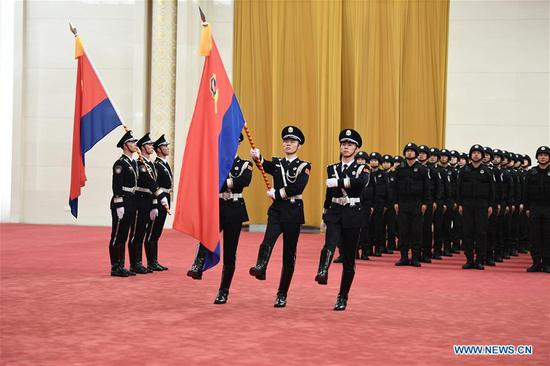 Ceremony to confer flag on China's police force held in Beijing