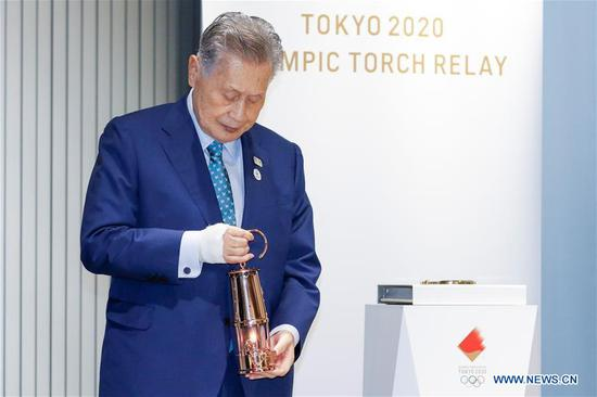 Tokyo 2020 President Yoshiro Mori holds the Olympic Flame during the display ceremony at the Japan Olympic Museum in Tokyo, Japan on Aug. 31, 2020. The Tokyo Olympic flame, which had been kept in a secret place since the Games was postponed, has been put on display at the Japan Olympic Museum on Monday. A simple ceremony was held by Tokyo 2020 organizers and the Japanese Olympic Committee (JOC) to mark the opening of the public display, which will run from September 1 to November 1. (Xinhua/Pool/Rodrigo Reyes Marin)