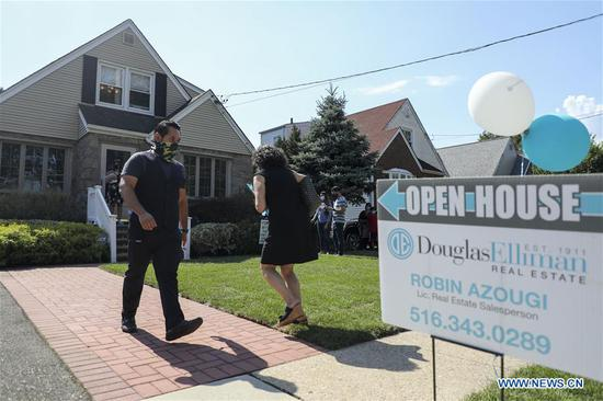 People wait to visit a house for sale in Floral Park, Nassau County, New York, the United States, on Sept. 6, 2020. Home buyers eying for cozy backyards and more office space are staging bidding wars in the suburbs surrounding New York City amid the spread of the COVID-19 pandemic. (Xinhua/Wang Ying)