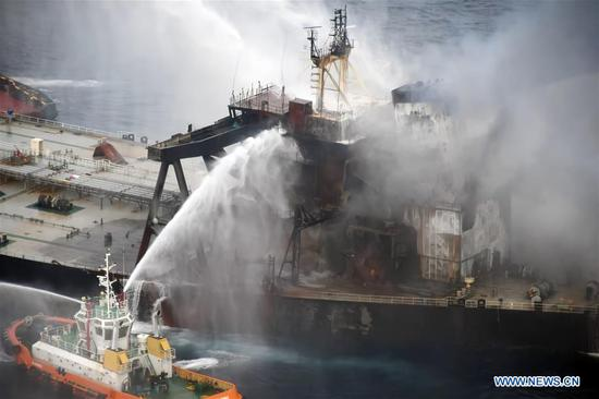 Fireboats extinguish fire of the MT New Diamond oil tanker in the seas off Sri Lanka's eastern coast, on Sept. 8, 2020. The Sri Lanka Navy on Wednesday said a fire which had reignited onboard the MT New Diamond oil tanker on Monday has been brought under control and the distressed ship was being towed further away towards safe waters by a tug boat. (Sri Lanka Air Force Media/Handout via Xinhua)